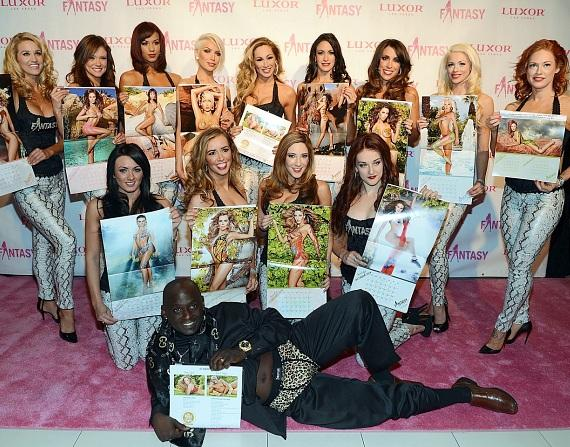 The ladies of FANTASY and Sean E. Cooper displaying their calendar pages on the pink carpet