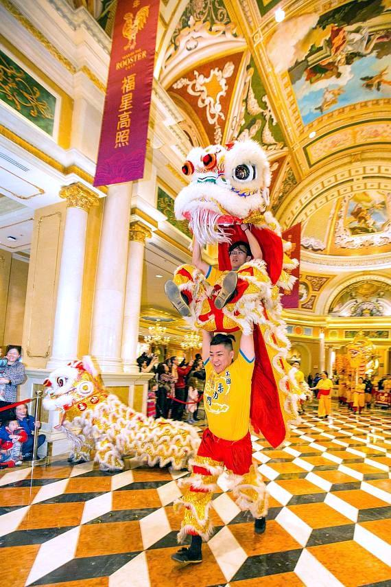 The lion dance makes its way through the Grand Colonnade at The Venetian