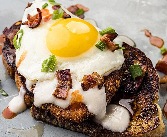 Caramelized French Toast + Cap'n Crunch Fried Chicken + Over Easy Egg + Chopped Bacon = The G.O.A.T. at Topgolf Las Vegas