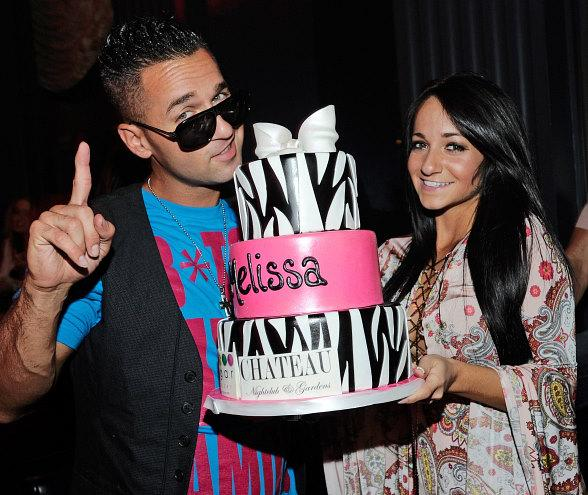 """Mike """"The Situation"""" Sorrentino presents his sister, Melissa, with a birthday cake at Chateau Nightclub & Gardens"""