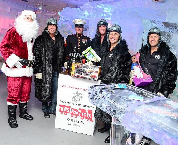 Thunder from Down Under donate to Toys for Tots accompanied by Santa and US Marines
