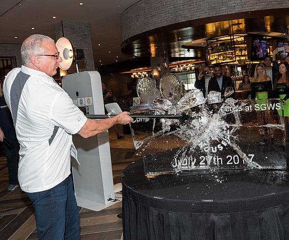 Chef Robert Irvine smashes the ice sculpture in his new restaurant at Tropicana Las Vegas