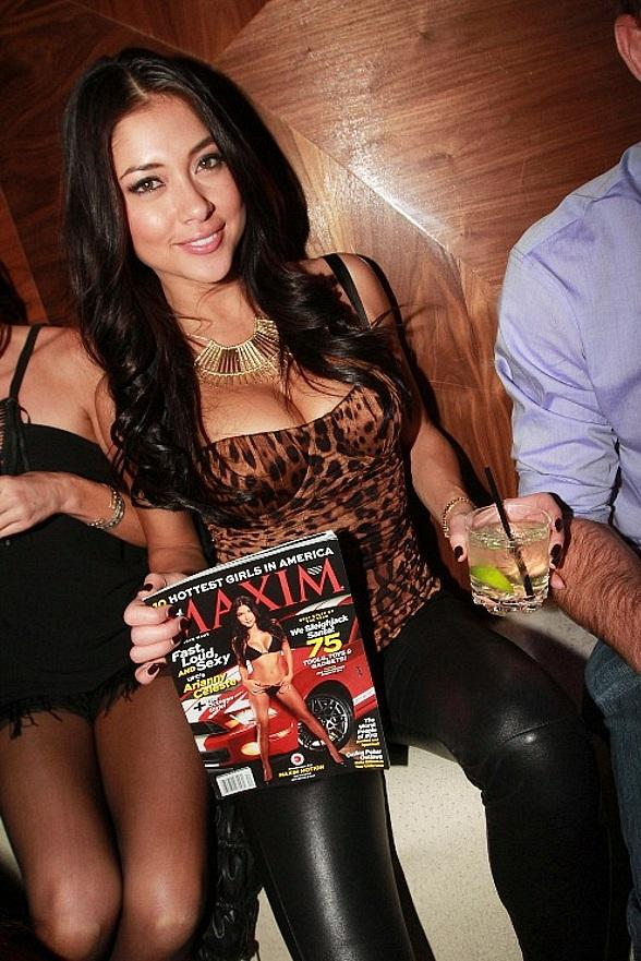 UFC Octagon Girl Arianny Celeste poses with her cover shot in the December issue of Maxim magazine