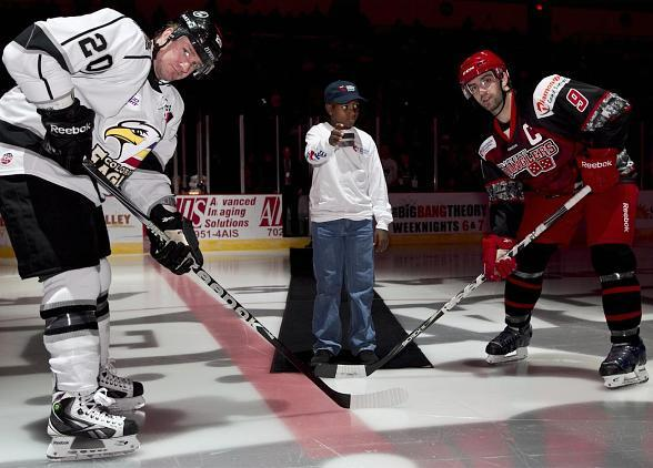 Sixth-grader and former UMC patient Keiontae Williams drops the puck for Children's Hospital of Nevada