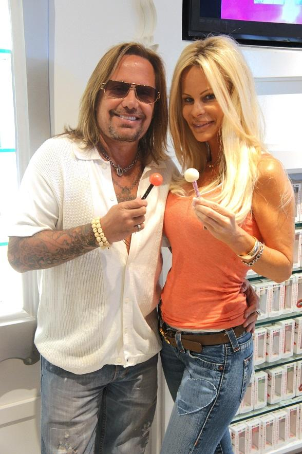 Vince Neil and Lia Gerardini with Couture Pops in the Sugar Factory retail store