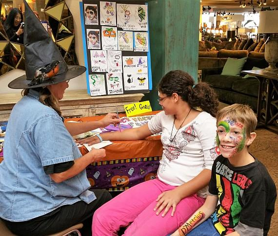 Free face painting in the Walker Furniture Atrium