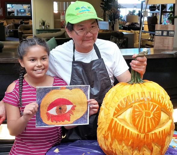 Student art winner Briana Magdaleno and Chef Boupha