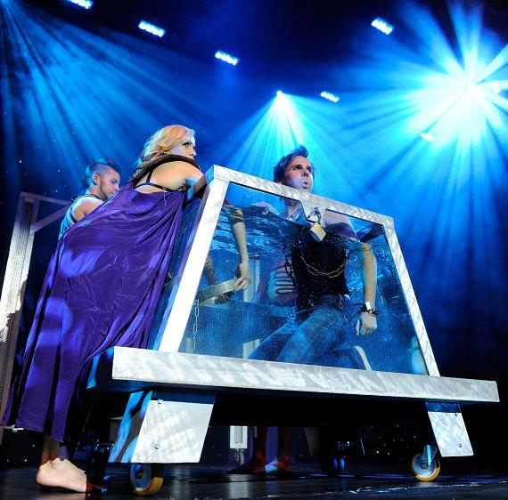 "Jan Rouven prepares to ""dive-in"" to his famous Water Tank illusion onstage during the Grand Opening of his new show ILLUSIONS in Las Vegas"