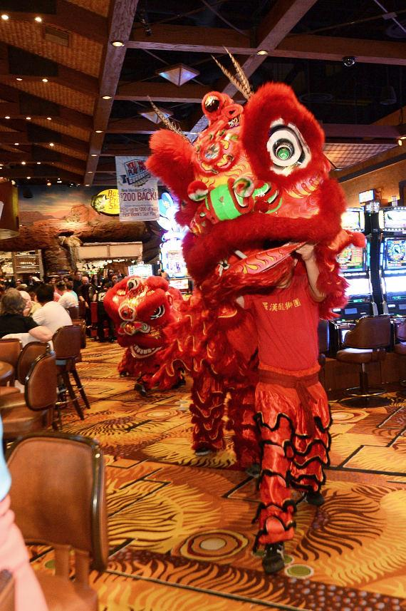Dancers perform traditional lion dance at the grand opening of WuHu Noodle inside Silverton Casino Hotel