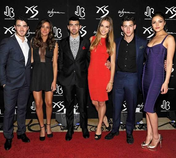 Jonas Brothers and girlfriends/wives at XS