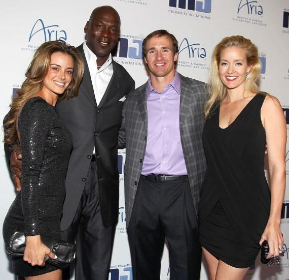 Yvette Prieto, Michael Jordan, Drew Brees and Brittany Brees on blue carpet at MJCI Celebration in Las Vegas