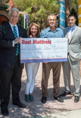 Best Mattress Presents Las Vegas' Favorite Charity, Opportunity Village, a check for $10,000