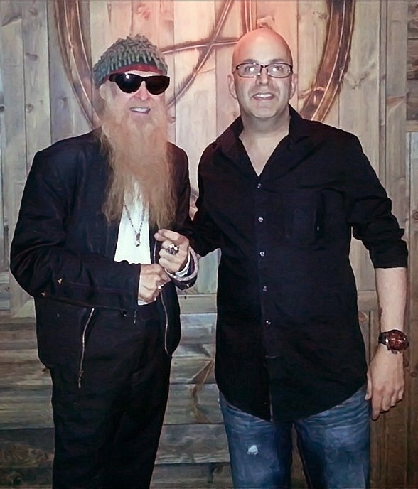 ZZ Top Guitarist Billy Gibbons poses with fan at The Ainsworth inside Hard Rock Hotel & Casino Las Vegas