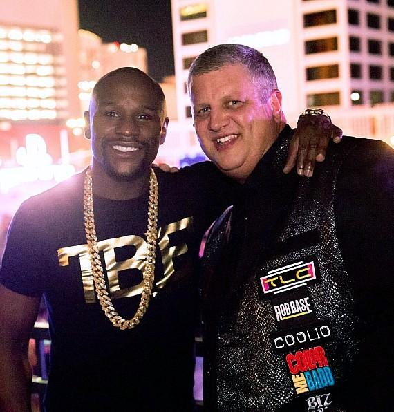 "Boxer Floyd Mayweather with Owner Derek Stevens at Downtown Las Vegas Events Center during ""I Love The 90s"" concert"