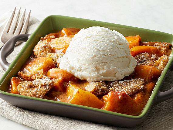 Snickerdoodle Peach Cobbler: Served warm with vanilla bean gelato, powdered sugar