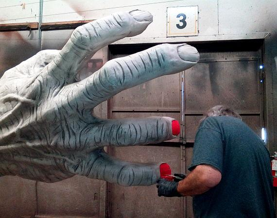 Ed Edmunds works on a scary clown hand