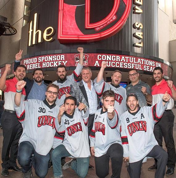 The D Owner Derek Stevens with UNLV Hockey Players and Coaches on Fremont Street at the D Casino Hotel Las Vegas