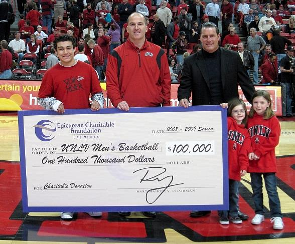 UNLV Associate Athletics Director for Development Bill Brady is presented with a $100,000 donation check from Epicurean Charitable Foundation Las Vegas