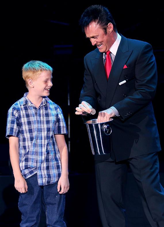 Master Magician Lance Burton with a young volunteer from the audience
