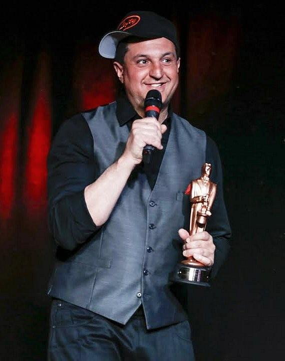 "Douglas 'Lefty' Leferovich, after receiving ""World Champion Magician Award for Manipulation"" from Tony Hassini, President of the International Magicians Society"