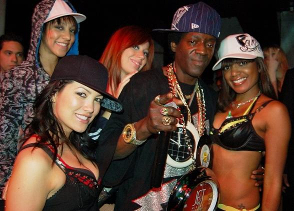 Flavor Flav with Go-Go Dancers (Photo Courtesy of The Light Group)
