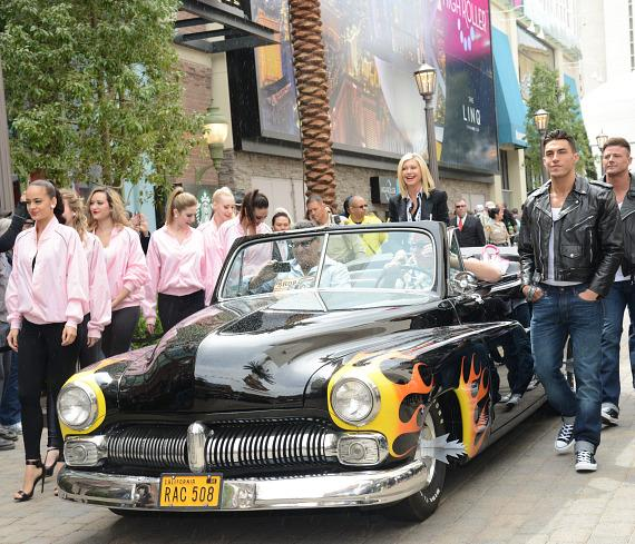 "Olivia Newton-John arrives at The Flamingo Las Vegas in the original  ""Hell's Chariot"" from the movie Grease."