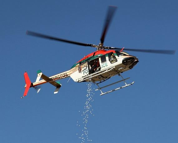"""Golf Balls from Heaven"" - a Metro helicopter dropped 1300 pre-numbered and pre-sold golf balls up over the driving range"