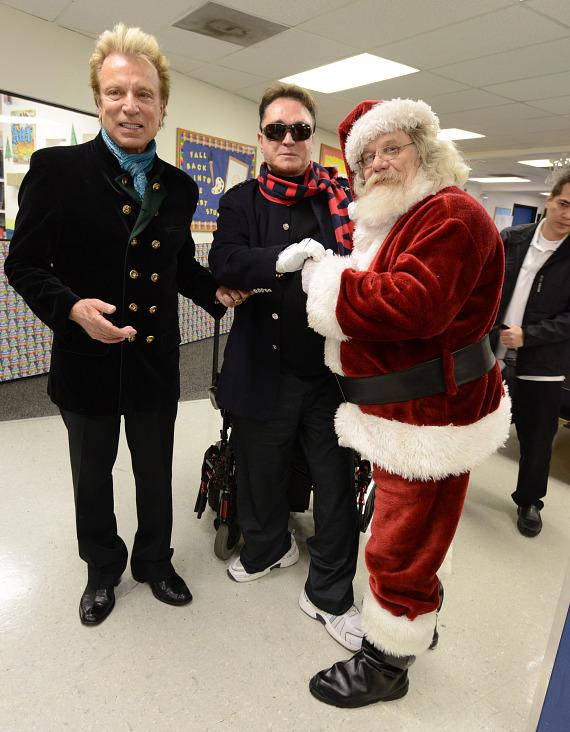 Siegfried & Roy meet Santa at The Boys & Girls Clubs Of Southern Nevada's Downtown Clubhouse
