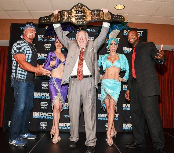 Hulk Hogan (L) with Former Mayor Oscar B. Goodman (with championship belt), TNA X Division champion Kenny King (R) and Las Vegas showgirls at Orleans Arena
