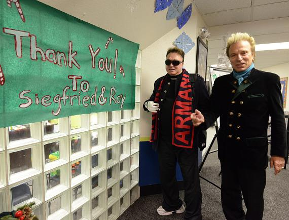 Siegfried & Roy with welcome sign at The Boys & Girls Clubs Of Southern Nevada's Downtown Clubhouse