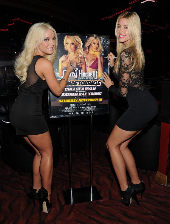 Chelsea Ryan and Heather Rae Young pose with poster at Crazy Horse III
