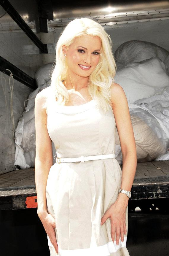 Holly Madison shows linens collected by Hard Rock Cafe