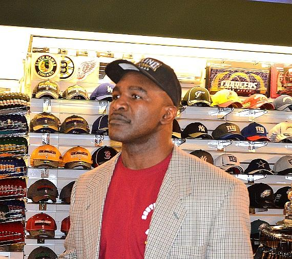 Evander Holyfield in the SCORE! gift shop