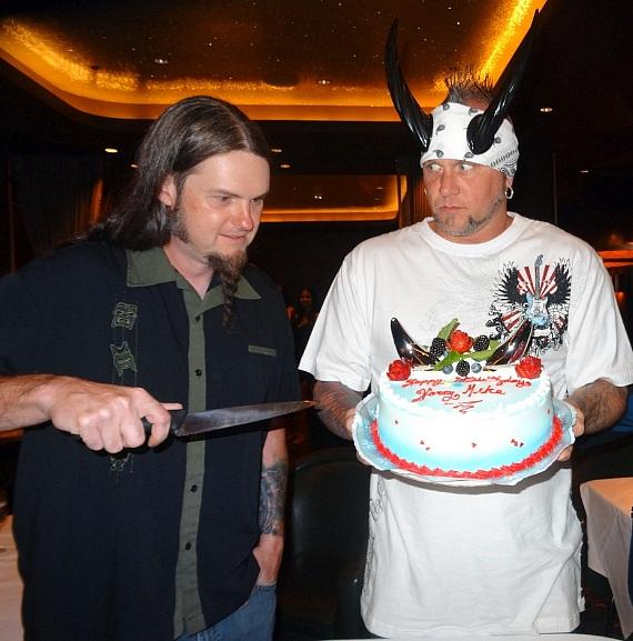 Ryan has the honor of cutting Horny Mike's birthday cake