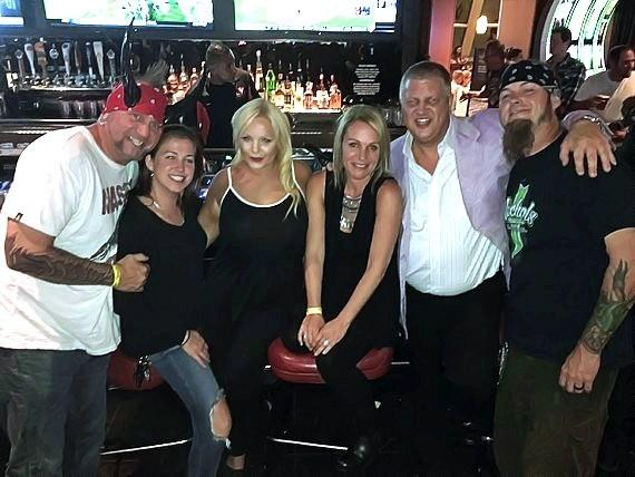 Counting Cars stars Horny Mike (r) and Ryan Evans (l) with the D Owner Derek Stevens (2nd from right) and his wife Nicole (3rd from right) and daughter Whitney at the D Casino Hotel Las Vegas
