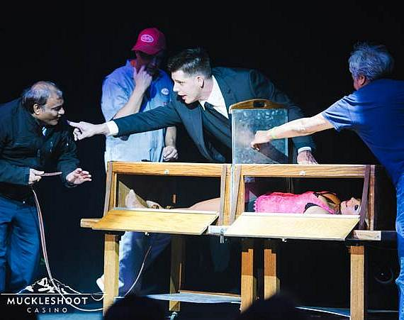 Illusionist Mark Bennick saws a woman in half at Muckleshoot Casino