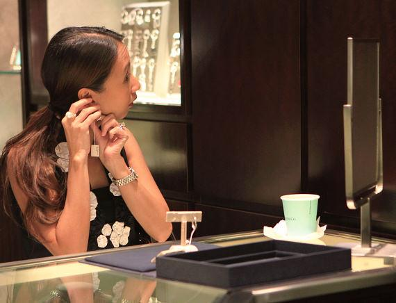 Guest tries on earrings at the Fashion's Night Out event to create fun fall looks at Tiffany & Co. inside Caesars Palace