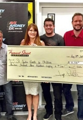 Fremont Street Experience and The Dave, Mahoney and DK Morning Show Present St. Jude's Ranch a Check for $13,380
