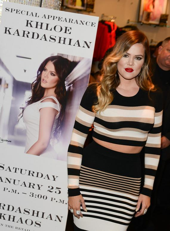 Khloe Kardashian poses with poster for her appearance at Kardashian Khaos at The Mirage Hotel & Casino in Las Vegas