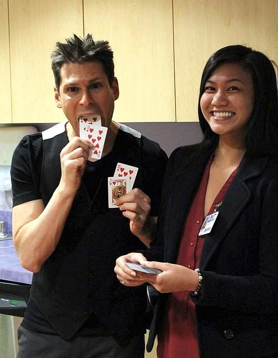 Mike Hammer performs magic with a staff member at UMC Children's Hospital