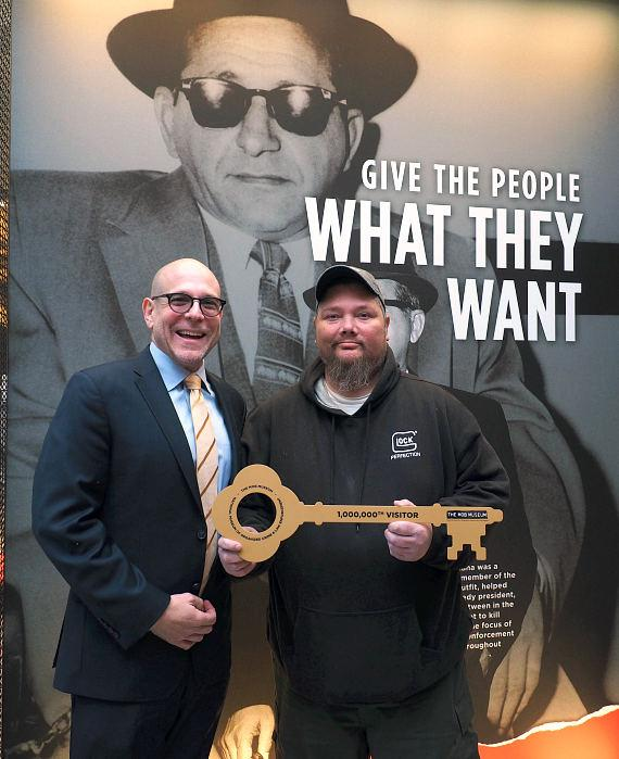 Jonathan Ullman, executive director, The Mob Museum with Billy Tveitnes of Las Vegas, 1 millionth visitor to The Mob Museum