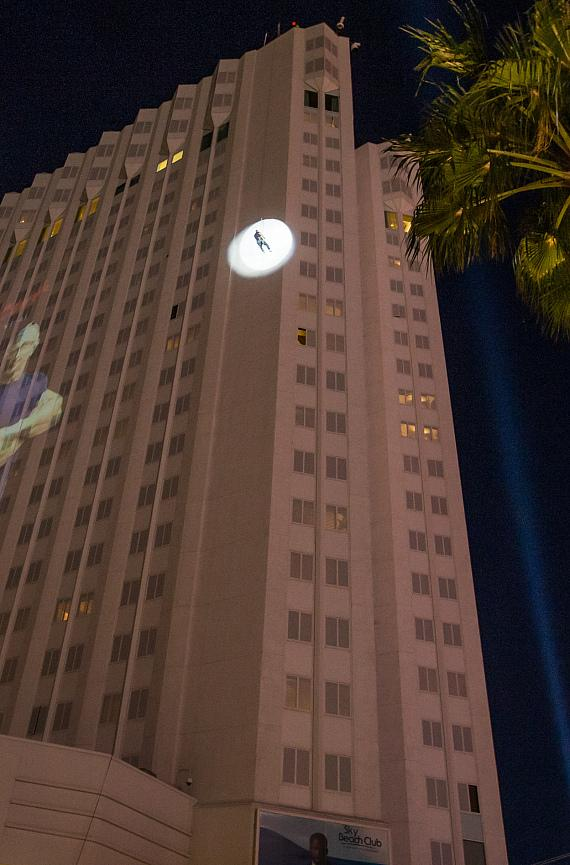 Robert Irvine makes his entrance by rappelling 22 stories (220 feet) down the exterior of the Tropicana hotel