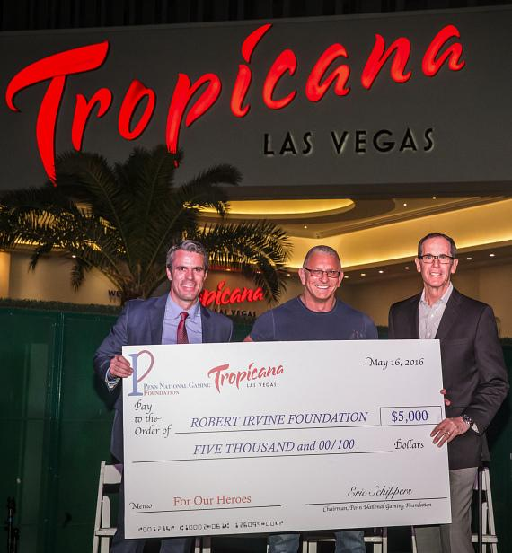Eric Schippers, Sr. Vice President of Public Affairs for Penn National Gaming, present Robert Irvine with a $5,000 check to benefit The Robert Irvine Foundation