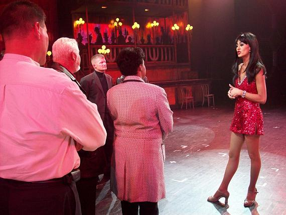 Folies Bergere Showgirl Janu Tornell gives Nellis Air Force base officials a look behind the scenes.