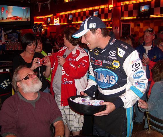 David Reutimann serving fans at NASCAR Cafe