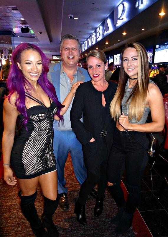 WWE Star Sasha Banks with the D Owner Derek Stevens, his wife Nicole Parthum, and WWE Star Emma at the D Casino Hotel Las Vegas