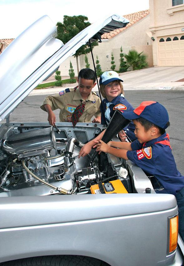 Members of Local Cub Scout Pack 830 check under the hood