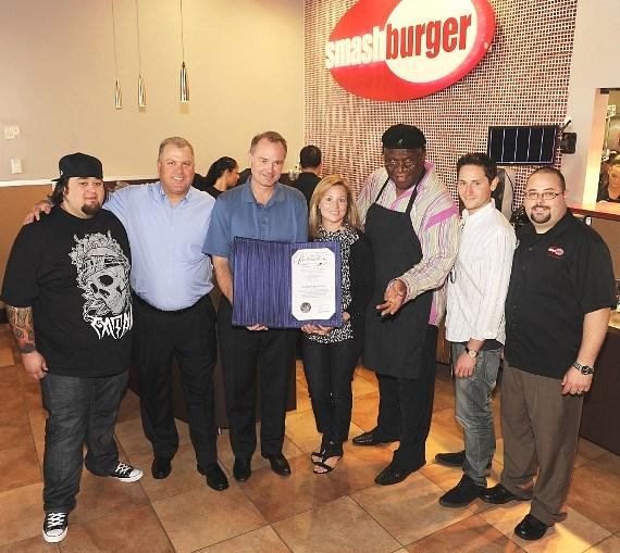 Chumlee, George Wallace and Smashburger franchisees Jerry and Kim Gunderson (center) and management