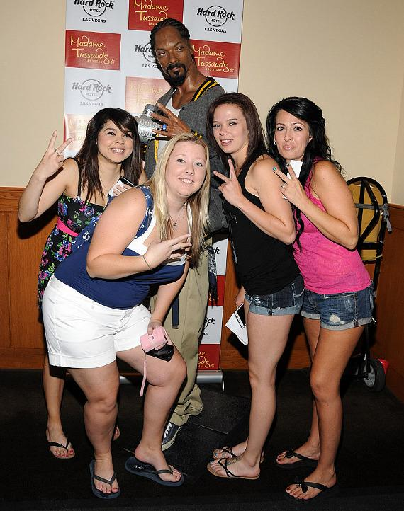 Fans pose with wax figure of Snoop Dogg at Hard Rock Las Vegas