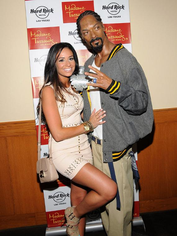 Fan poses with wax figure of Snoop Dogg at Hard Rock Las Vegas